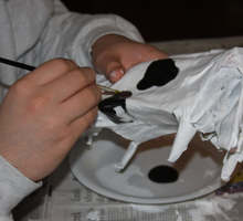 Make a paper mache cow